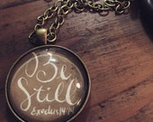 "Exodus 14:14 - Be Still - 1 1/4"" Bronze Glass Pendant"
