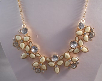 Bib Necklace With off White Beads and Clear Crystal Beads on a Gold Tone Chain