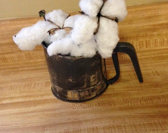old flour sifter with real natural cotton