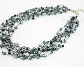Dark grey freshwater pearl on silk necklace.