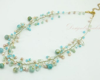 Baby blue crystal,freshwater pearl on silk thread necklace.
