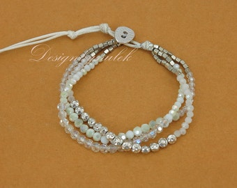 White crystal and silver plated beads on wax cotton bracelet.