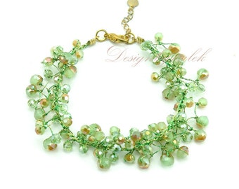 Peridot crystal hand knotted on silk bracelet.