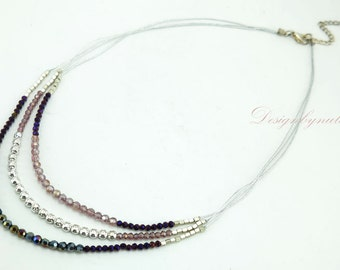 Amethyst crystal on silk necklace.