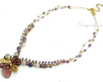 Amethyst and crystal on silk thread necklace.