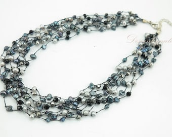 Dark grey freshwater pearl on silk necklace.