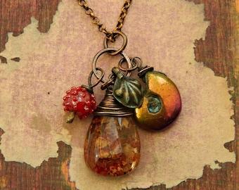 Gypsy,Boho ,Ethnic, kuchi,Red Quartz lodolite , Ammonite fossil,lampwork copper necklace