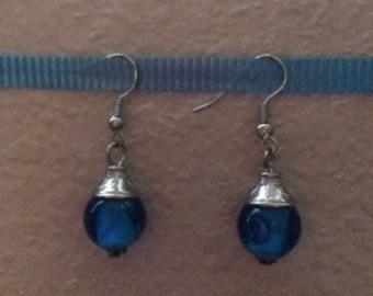 Blue swirl glass bead earrings.