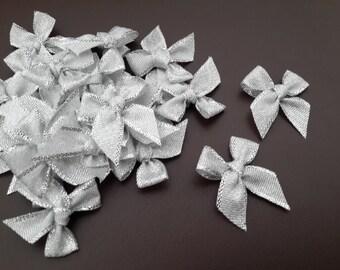 100 PCS of SILVER Ribbon Bow Applique Embellishments