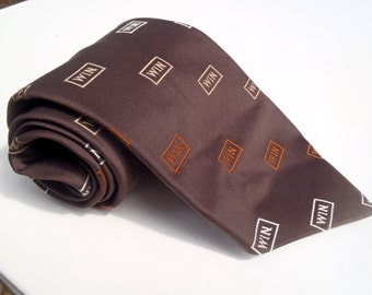 Vintage 1970s Wide Brown Tie with Tan and Orange WIN Club Pattern