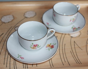 Pair of beautiful antique children's coffee cups by Arabia Finland