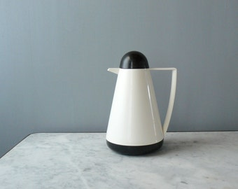 Vintage thermos. 1960s thermos bottle with black cap. Guzzini thermos