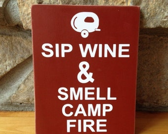 camping and sipping wine
