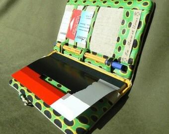 Door, cheque book, card and pencil