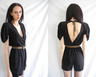 80's black goth/rocker open back and plunging front playsuit with embellished shoulder detail
