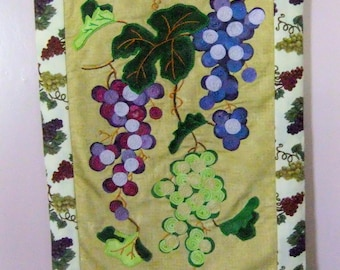 Fabric wall hanging with grape clusters