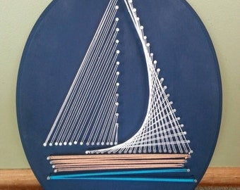Nautical Sailboat String Art on a Navy Blue Oval Plaque