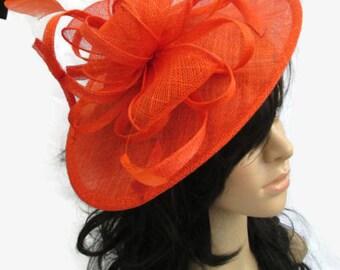 Stunning Orange Sinamay Shaped disc Fascinator with double swirls , loops..wedding,races