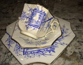 Aesthetic ware blue transfer ware cup, saucer and tea plate with gold edging circa 1884