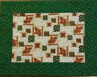Handmade Christmas Placemats.  Set of 4.  Bright greens, golds, reds with stars, poinsetttias and holly leaves.