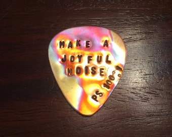 Tempered Copper Guitar Pick. DOES NOT INCLUDE Aluminum Tag.
