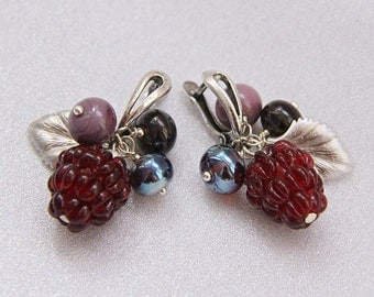 Lampwork glass raspberry earrings with silver color metal leaves.