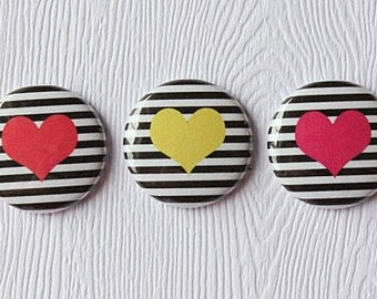 """3 badges 1 """"hearts lines red, yellow, Fuchsia"""