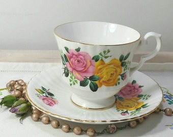 Vintage bone China Teacup and saucer made by Royal Windsor China with pink and yellow roses and gold gilding. TS078