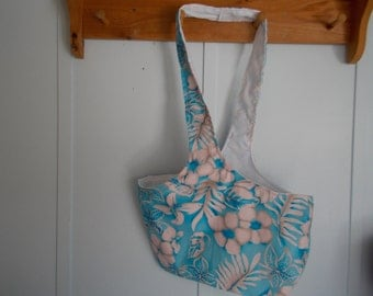 Hobo bag.Bight blue Hawaiian floral with white flowers and white lined reversible