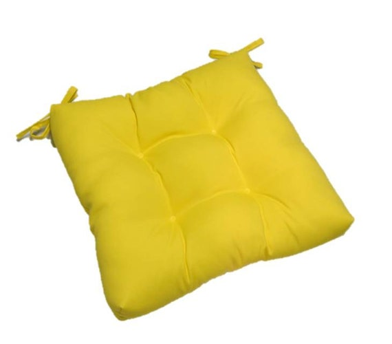 solid yellow tufted cushion pad with ties for kitchen dining