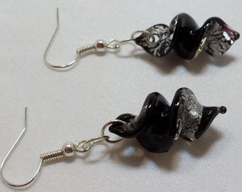 Black and silver swirl dangle earring.