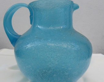 Nice and opaque vintage murano pulegoso glass pitcher.