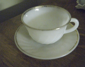 FIRE KING milk glass  cup and saucer White with swirl pattern and gold trim