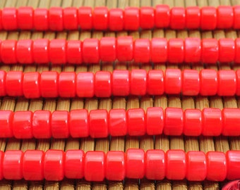 96 pcs of Red Coral smooth wheel beads in 4x6mm