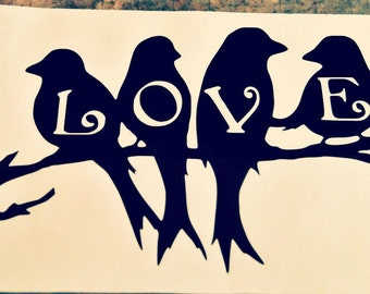 Four Birds Sitting On A Branch With The Letters LOVE Emblazoned On Their Chests