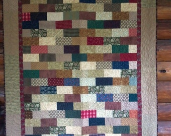 "A ""brick"" quilt.  Warm colors. 54 x 80 inches."