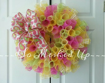 Deco Mesh Spring wreath in sherbet colors with a paisley print bow done in spiral style!