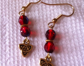 Red with blue and gold plated pierced earrings with Celtic knot charms.