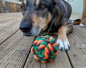 Rope ball dog toy in Orange, Brown, and Green
