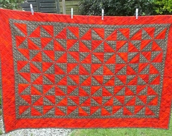 Patchwork Lap Quilt Blanket/Throw/Picnic rug  52 x 36 inches all loviingly hand quilted. Red and black cotton fabric pin wheel design cover