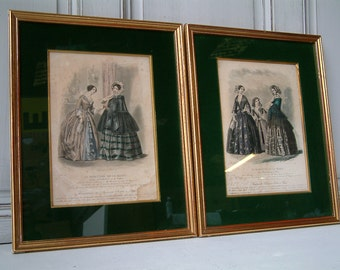 Set of 2 antique french fashion plates in gold frames with green velvet borders. Women in mid 19th century costume. Paris fashion plates.