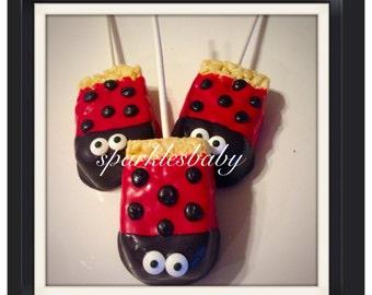 Ladybug party - Ladybug chocolate covered Rice Krispie treat pops