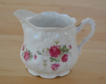 White vintage creamer with bright pink magenta shabby chic roses