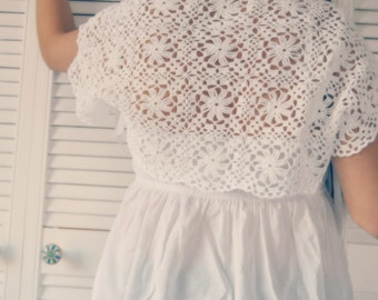 Crochet lace white bridal shrug for a romantic wedding with satin bows