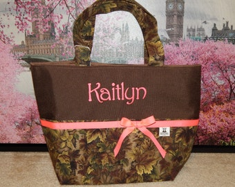 Personalized mossy oak diaper bag or tote bag with neon pink ribbon