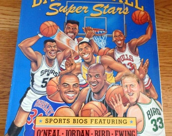 NBA, Basketball Super Stars 1994- by David Gowdey.  Contains great glossy pages, caricatures,  bios on O'Neal,Jordan, Bird. Basketball stars