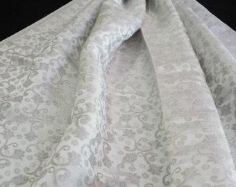 Reversible silver on white rose vine pattern jacquard brocade woven fabric