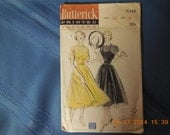 Butterick sewing pattern #5346 size 14 ladies dress.  This pattern is from the 1940s, original cost 50 cents.