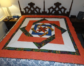 Labryinth hand made quilt, approx 76x74 in. done in oranges & tribal fabric