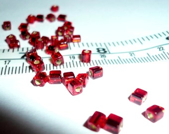 9g x 3mm red cube barrel beads. silver lined beads new.  UK seller